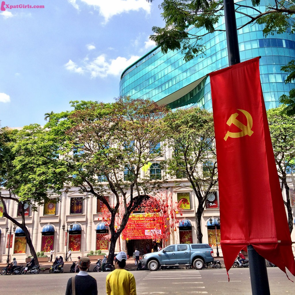 The proud communist flag raising in the streets of Ho Chi Minh City