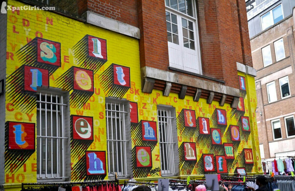 Just around the corner, when you enter from the Liverpool Street end is a building covered in work by street artist Ben Eine.