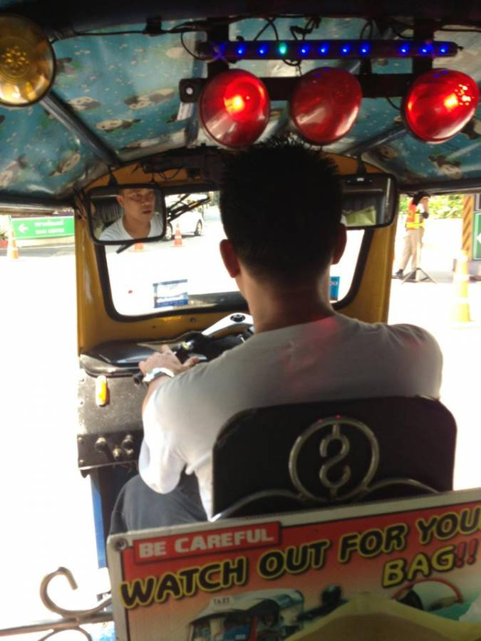 Riding in the back of a TukTuk