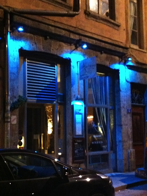 Our favorite restaurant in Lyon at night.