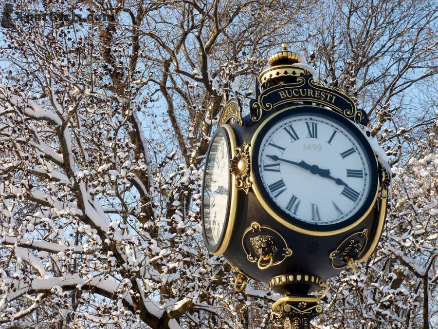 A snowy ornamental clock in one of Bucharest's many parks