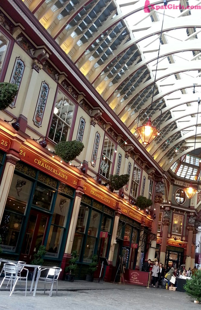 Leadenhall Market - covered by an ornate roof structure, painted green, burgundy, maroon and cream with cobbled floors below. I think it's a rather fine piece of Victorian architecture.