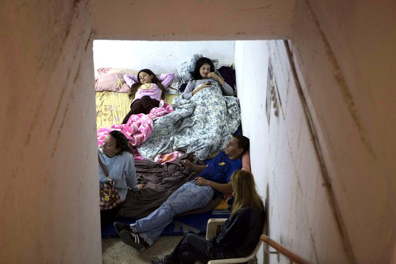 Israelis prepare to spend the night in a bomb shelter in the southern Israeli city of Beersheva