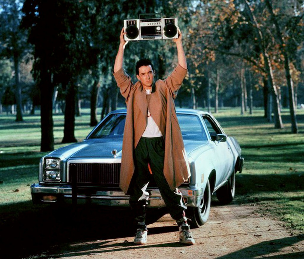 """John Cusack in """"Say anything"""", holding a radio over his head to play """"In Your Eyes"""" for his girlfriend. They're broken up, both in pain, and the Peter Gabriel's song was the one they had first made love to."""